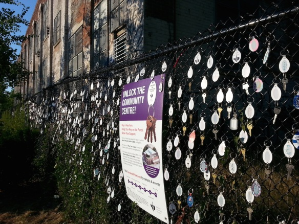 Hundreds of keychains with supporter names on the fence outside the future community centre. Growing every day!